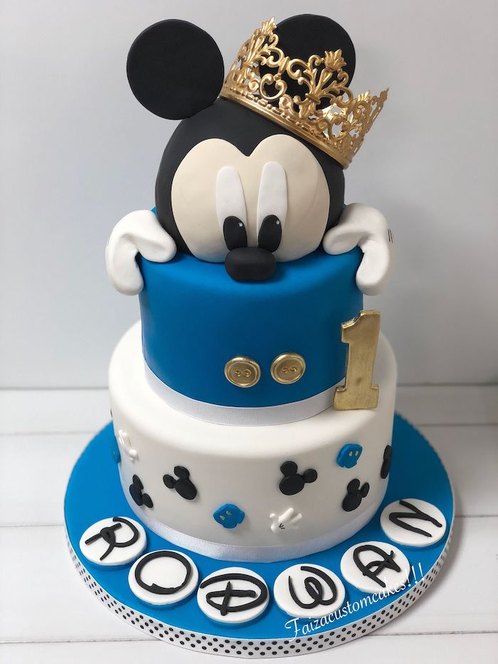 two tier cake, covered with blue and white fondant, mickey mouse birthday cake, gold crown decoration