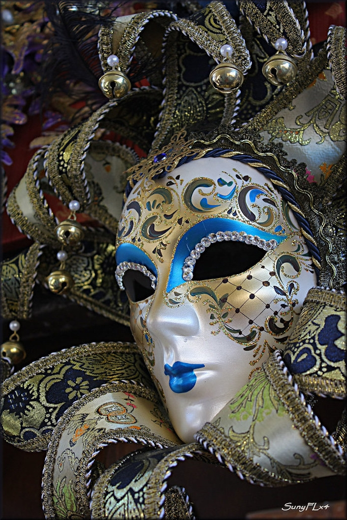 venetian mask, mardi gras mask, decorated with gold and blue, rhinestones around the eyes, bells at the end