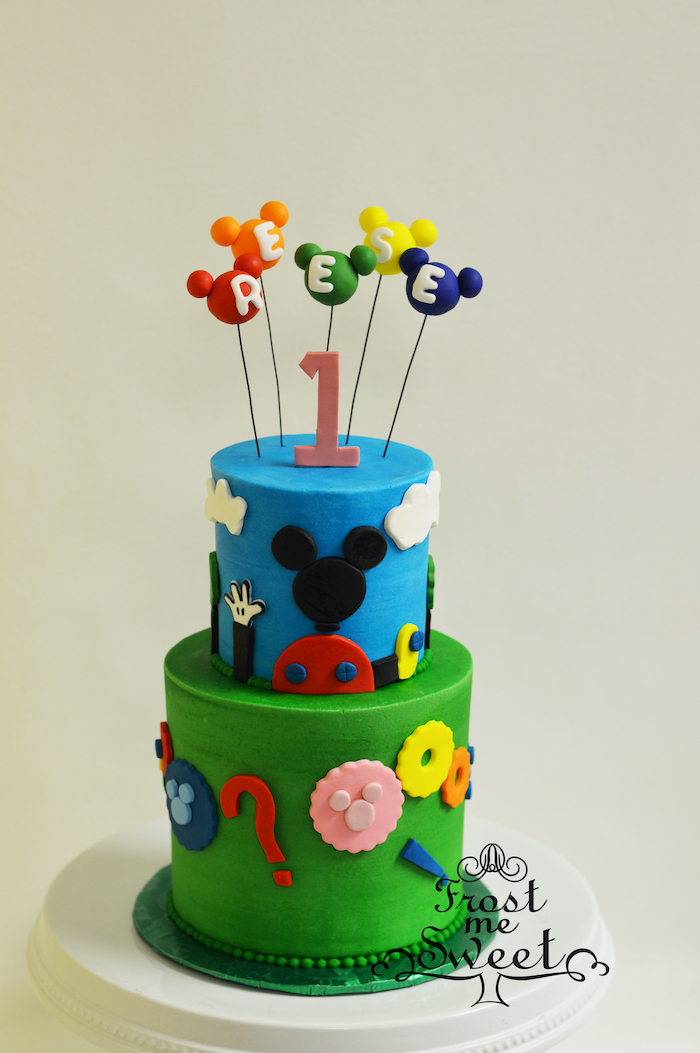 mickey mouse birthday cake, two tier cake, covered with blue and green fondant, mickey cake pops for cake toppers