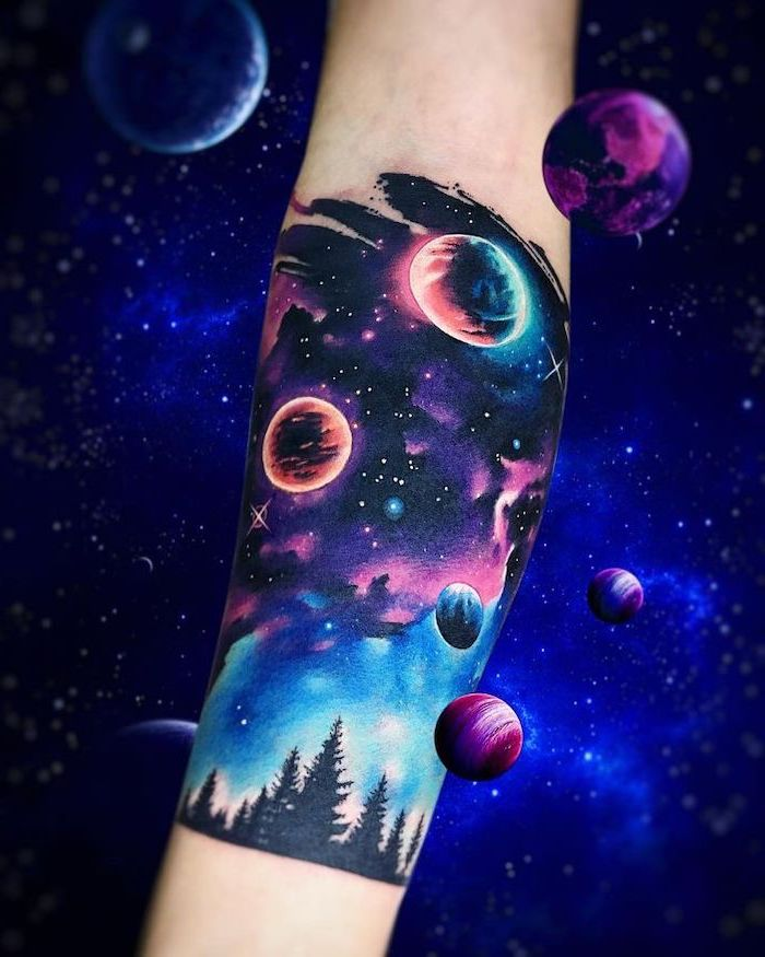 galaxy tattoo, forearm tattoo of galaxy in purple pink and blue colors, stars and planets above tall trees