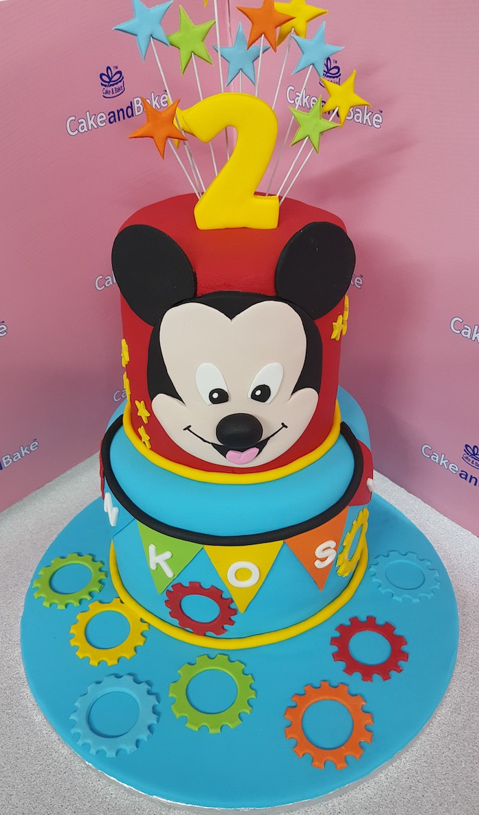 celebration cakes, two tier cake, covered with red and blue fondant, decorated with fondant stars cake toppers