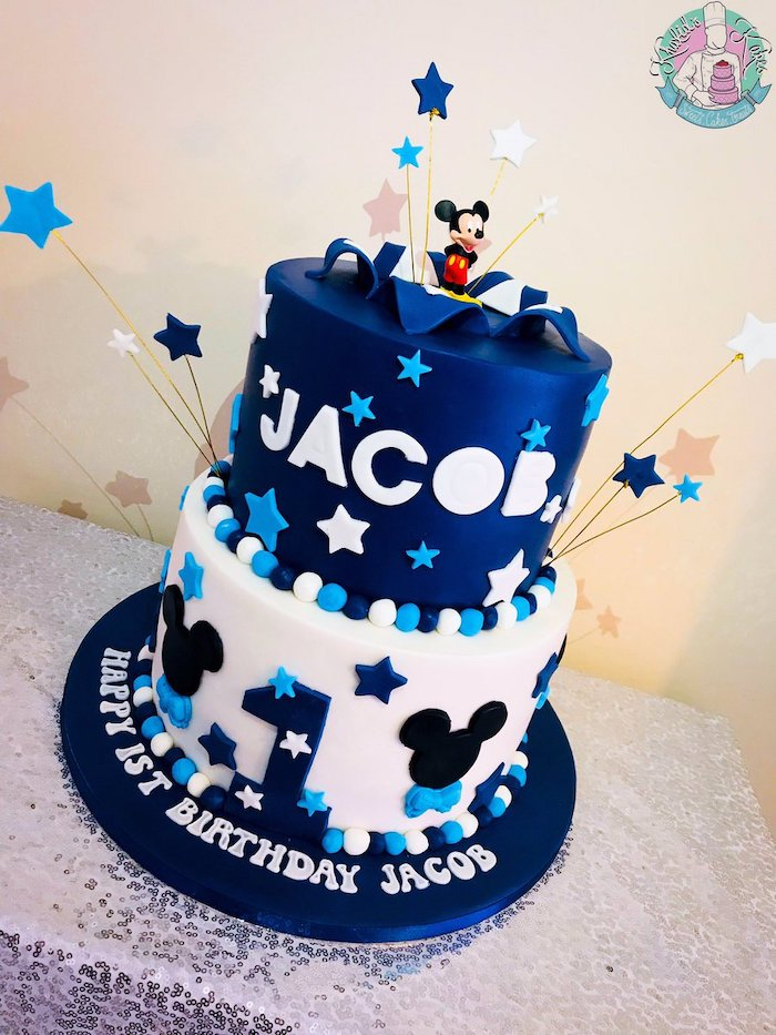 two tier cake, covered with blue and white fondant, celebration cakes, decorated with blue and white stars