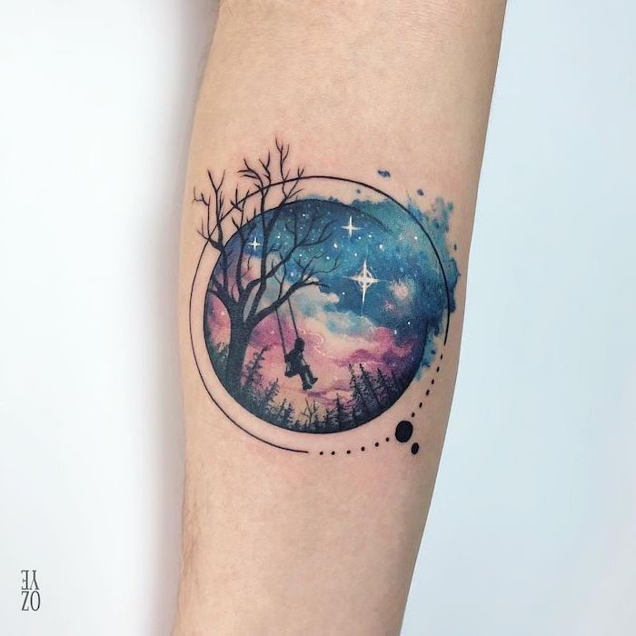 forearm tattoo, girl swinging on a swing hanging from tree, moon and stars tattoo, galaxy in the background with stars