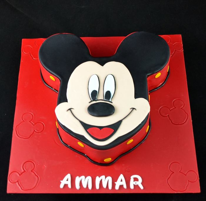 mickey mouse 1st birthday cake, cake in the shape of mickey's head, decorated with black white and red fondant