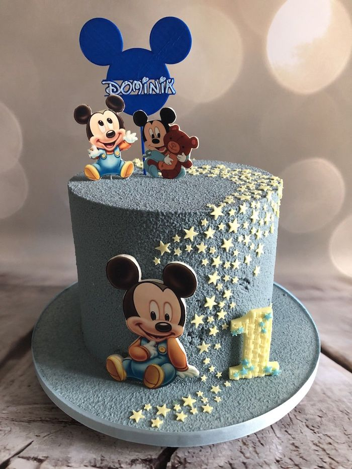 one tier cake, covered with dark grey buttercream, yellow fondant stars, mickey mouse birthday cake, mickey cake toppers