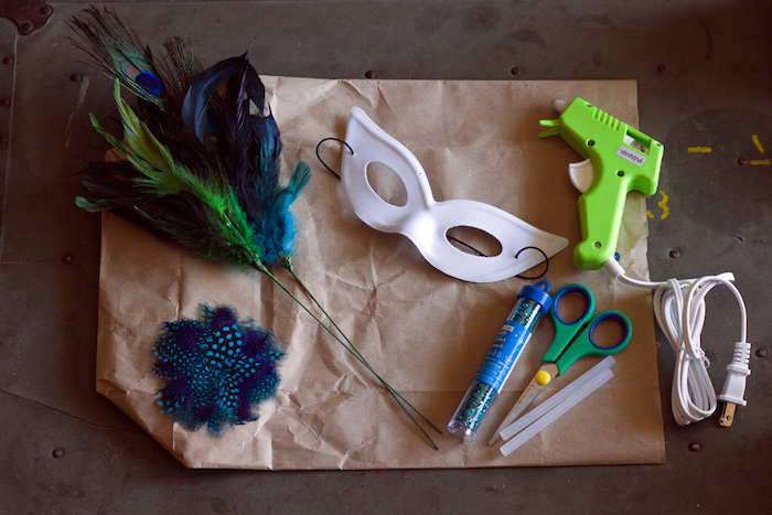needed supplies for crafts, masquerade masks for couples, step by step diy tutorial, deathers and mask, glitter and glue