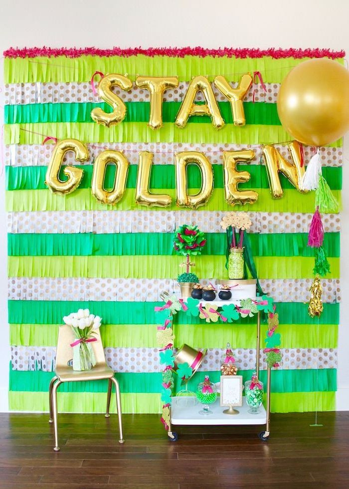 stay golden balloons, hanging on wall with green fringe paper garlands, happy st patrick's day, cocktail bar