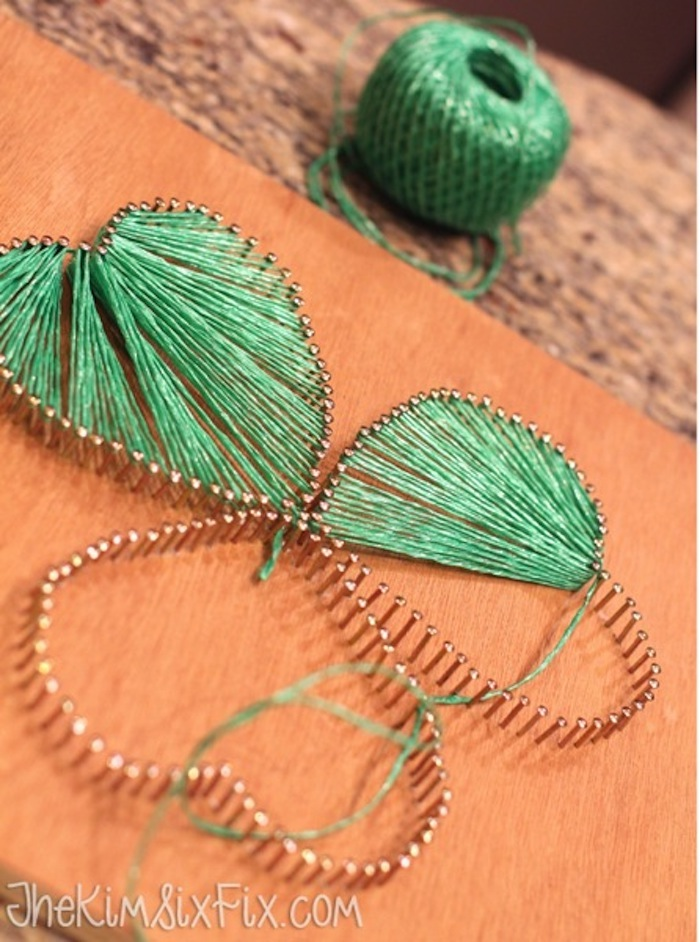 st patrick's day accessories, shamrock string art, step by step diy tutorial, green thread connecting nails on wooden block