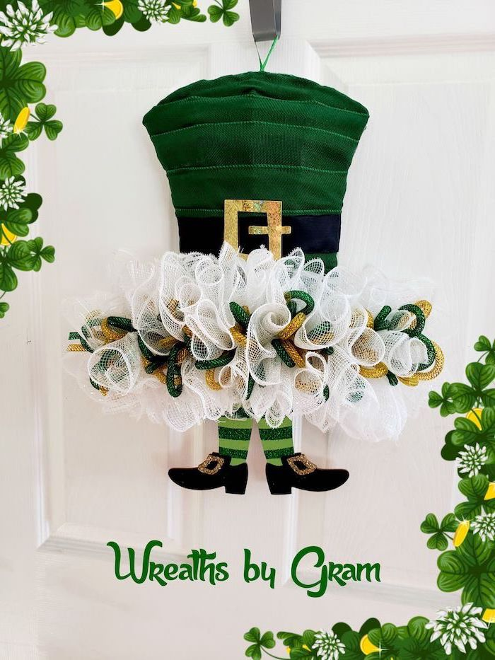 wreath made with white gold and green glitter, st patrick's day party, green hat and elf's feet, hanging on white door