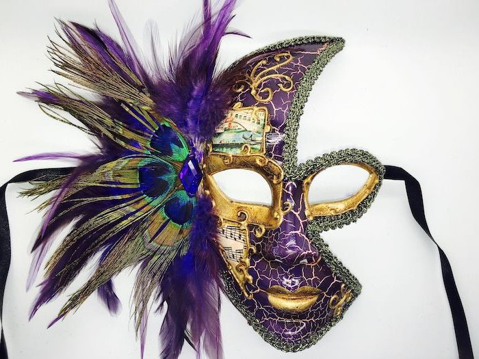 purple mask with gold decorations, male masquerade masks, purple and green peacock feathers, black ribbons
