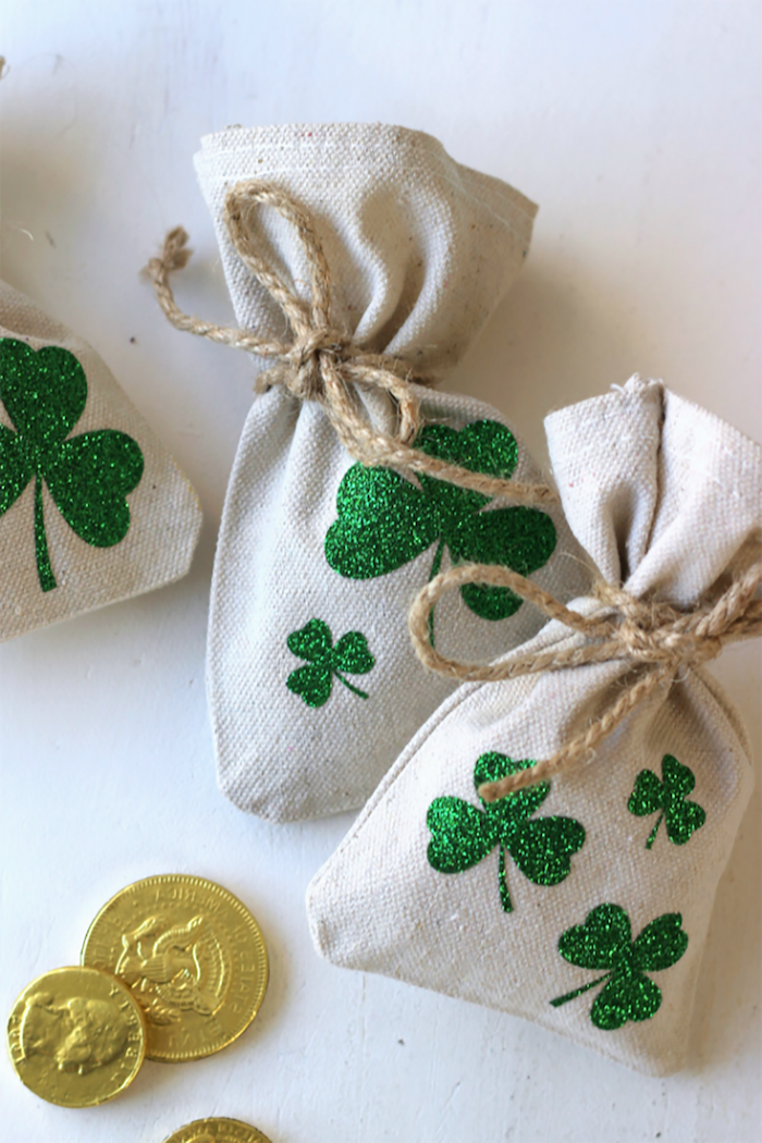 small pouches decorated with green glitter shamrocks, st patrick's day party, gold coins on the side