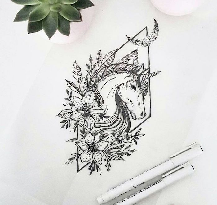 black and white pencil sketch of a unicorn, surrounded by flowers, how to draw a cute unicorn, drawn on white background