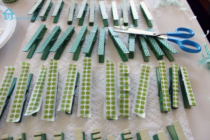 step by step diy tutorial, lots of clothespins, covered with green washi tape with different patterns, st paddy's day