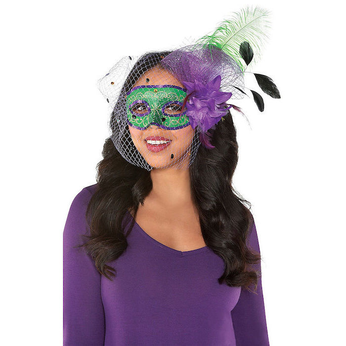 masquerade party masks, woman wearing purple blouse, green mask with purple decorations, green feathers and tulle