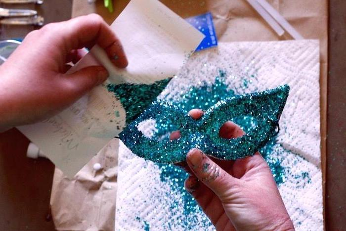 white mask covered with turquoise glitter, masquerade masks for couples, step by step diy tutorial