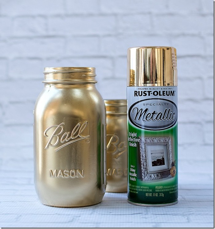 step by step diy tutorial, st patricks day crafts, mason jar painted in gold, spray can next to it, placed on white surface