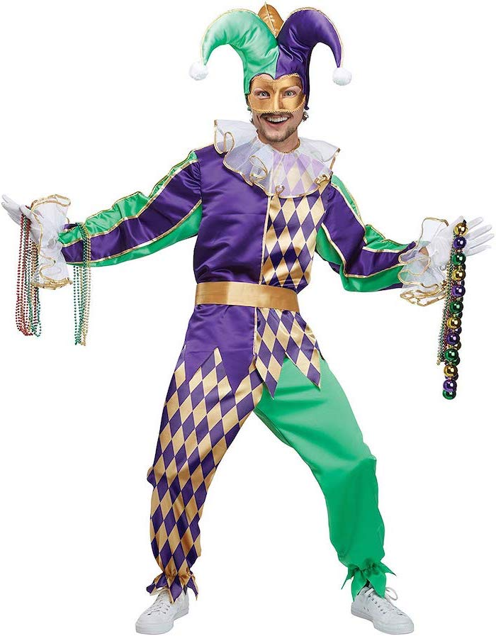 man wearing a gold green and purple jester costume, masquerade ball masks, gold mask and jester hat, lots of bead necklaces