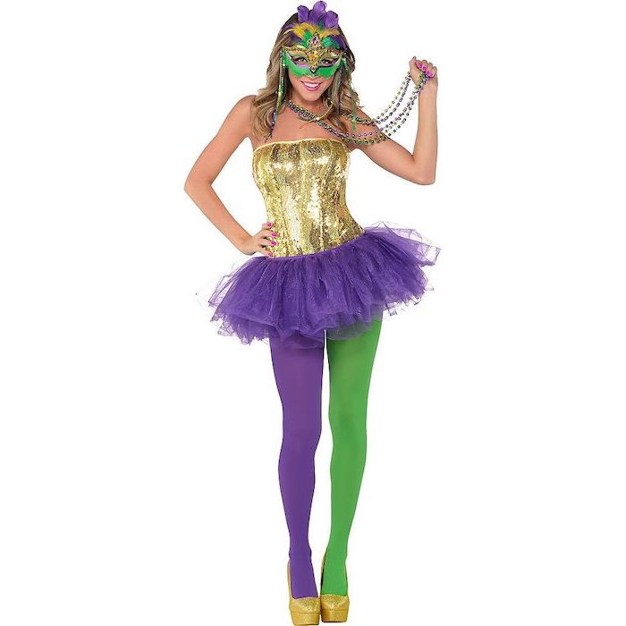 woman wearing purple green and gold costume, beads necklaces, masquerade party masks, green and gold purple mask