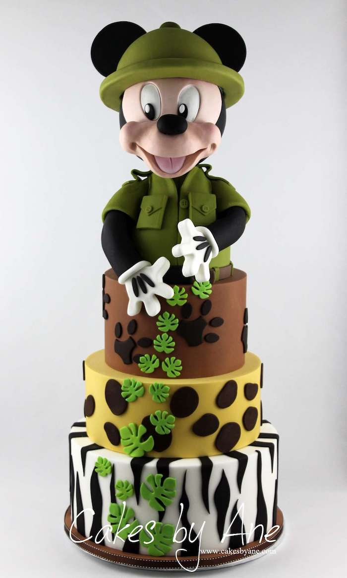 safari cake, mickey cake, four tier cake, covered with white and black, green brown and yellow fondant
