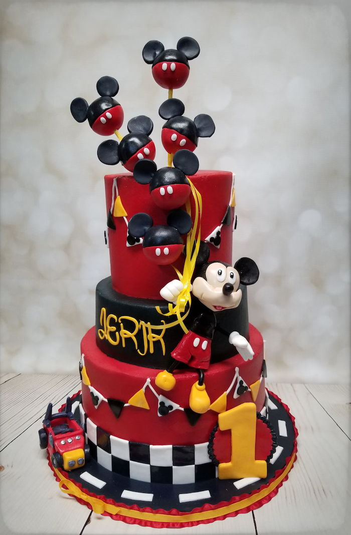 three tier cake, covered with red black and white fondant, mickey cake, mickey cake pops cake toppers