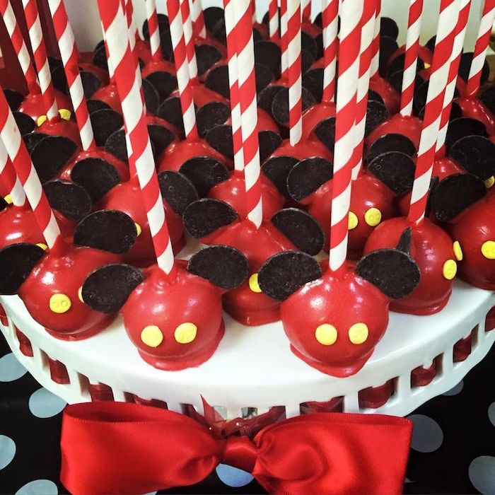 cake pops, covered with red chocolate, mickey mouse cakes 1st birthday, arranged on white cake stand