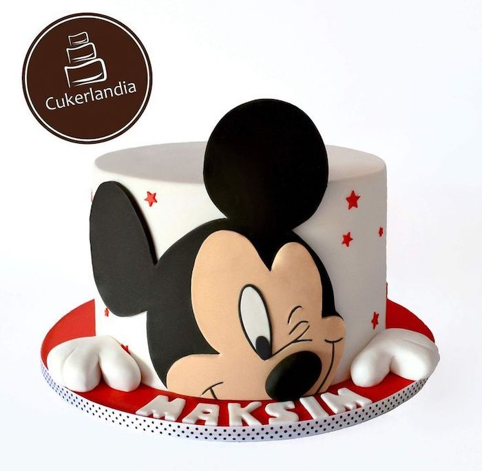 one tier cake, covered with white fondant, mickey mouse smash cake, mickey made of fondant, red stars on the cake