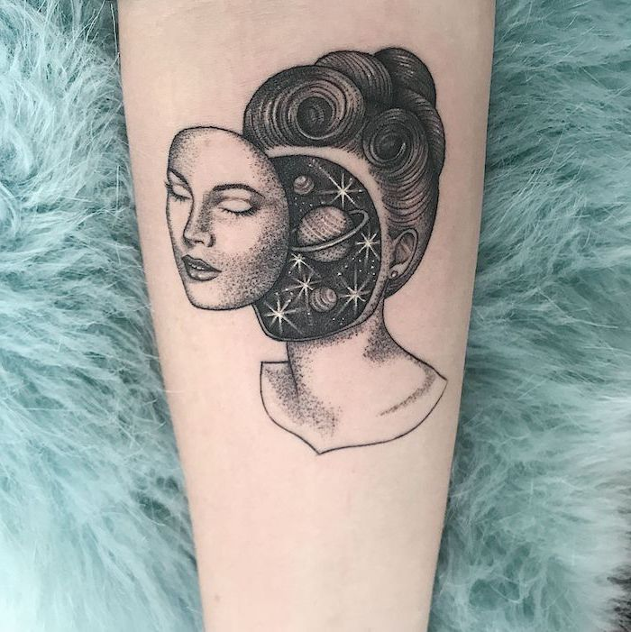 space themed tattoos, black and white forearm tattoo, female face with galaxy inside her head