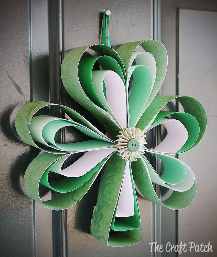 paper shamrock, made with white and green paper, st patricks decor, hanging on black wooden door
