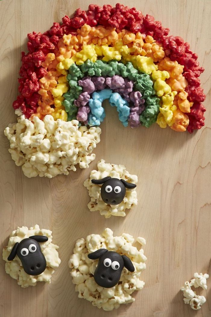 popcorns arranged as a rainbow, st patrick's day crafts, popcorn sheep, arranged on a wooden surface