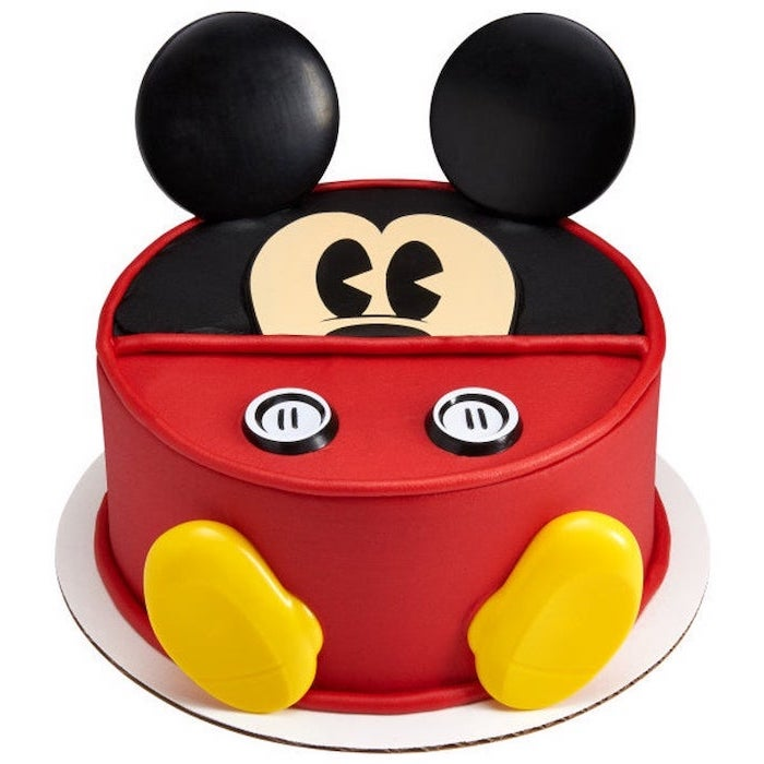 one tier cake, covered with red and black fondant, mickey mouse cake pops, placed on white cake tray