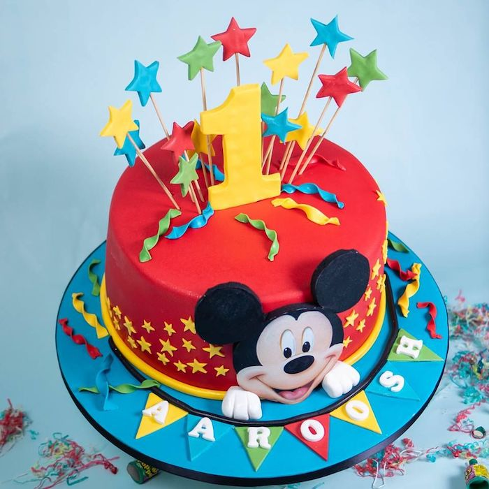 mickey mouse cake pops, one tier cake, covered with red fondant, fondant stars for cake toppers