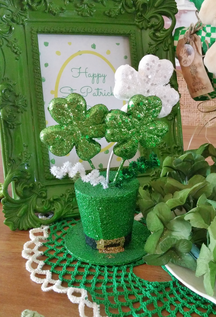 st patricks day games, foam hat covered with green glitter, white and green glitter shamrocks on top of it