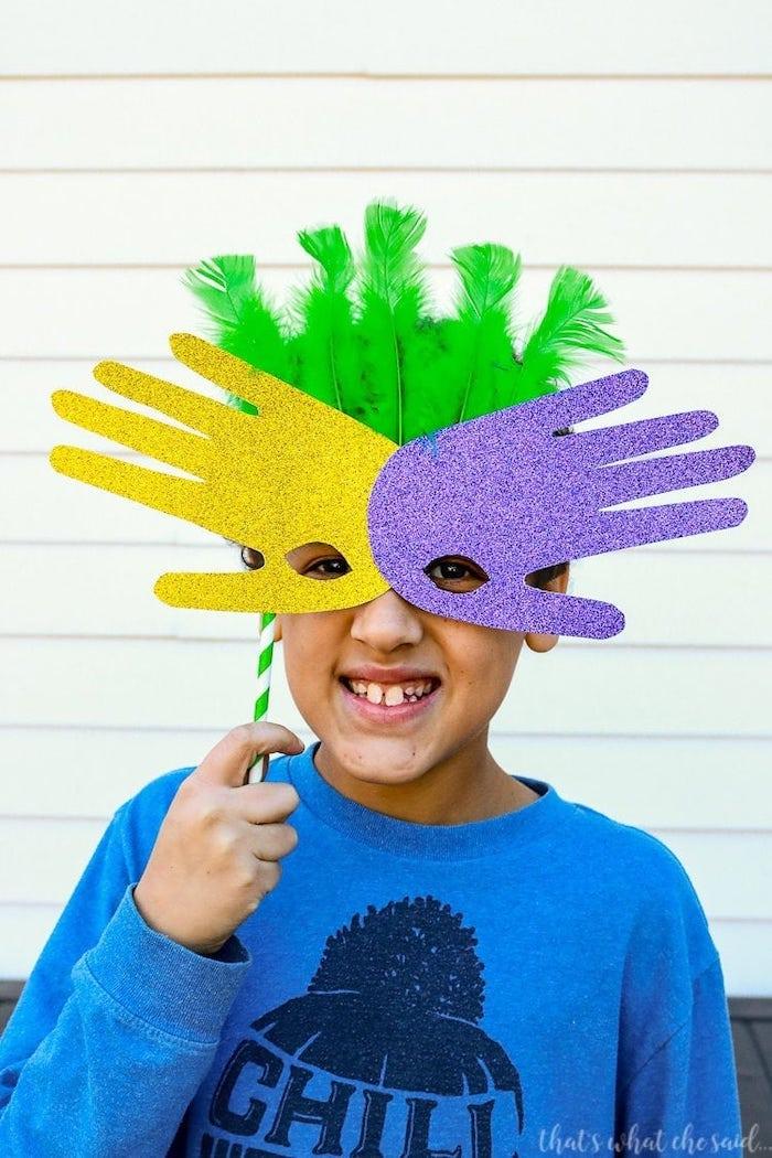 step by step diy tutorail, masks made of handprints, masquerade ball masks, boy wearing the mask