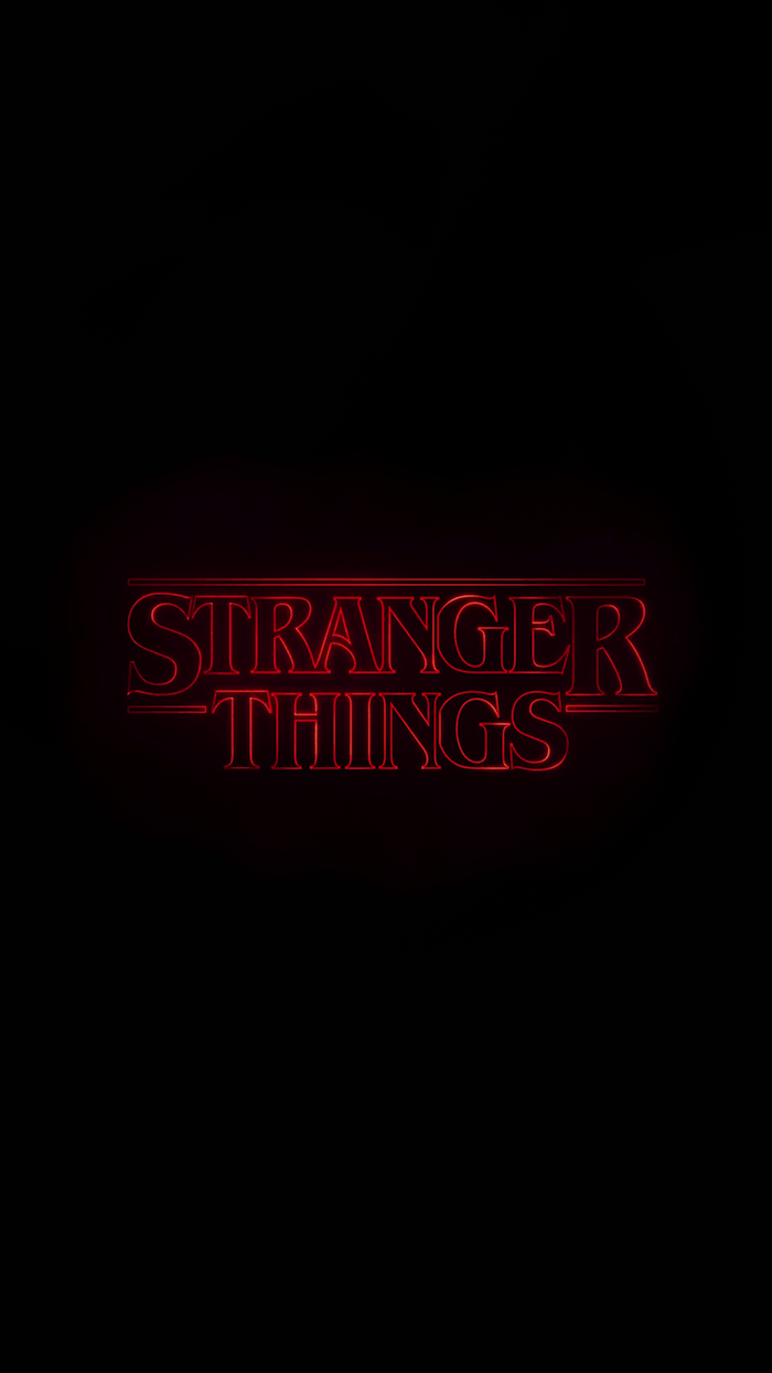 stranger things wallpaper, title logo of the show, written in red neon on black background