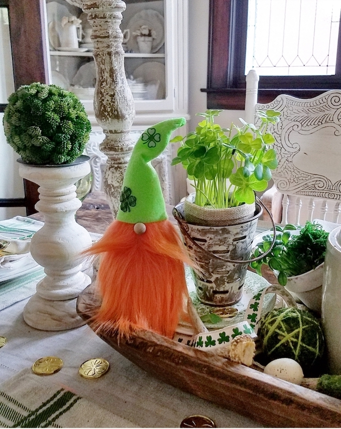 pots with green plants, arranged on plate, st patricks day games, gold coins scattered around, elf toy with ginger beard
