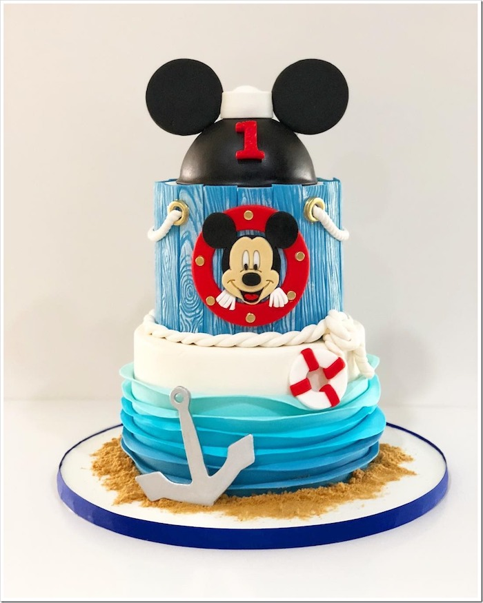 nautical themed cake, mickey mouse cake pan, two tier cake, covered with blue white and black fondant