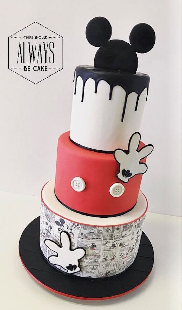 three tier cake, covered with white and red fondant, black fondant dripping on the sides, mickey mouse cake pan