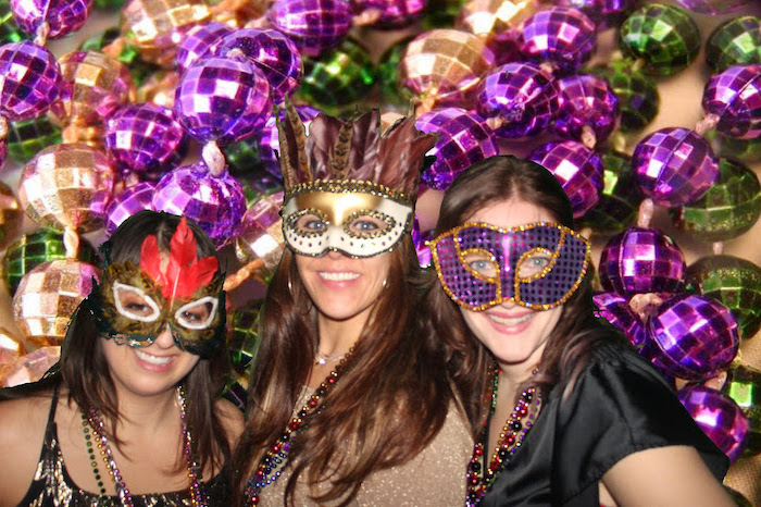 three women smiling, posing for a photograph, what to wear to mardi gras, wearing different masks in gold and purple