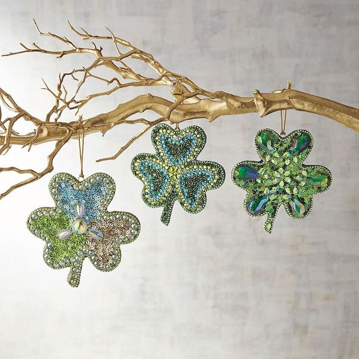 tree branch painted in gold, three shamrocks hanging on it, covered with rhinestones, st patrick's day wreath