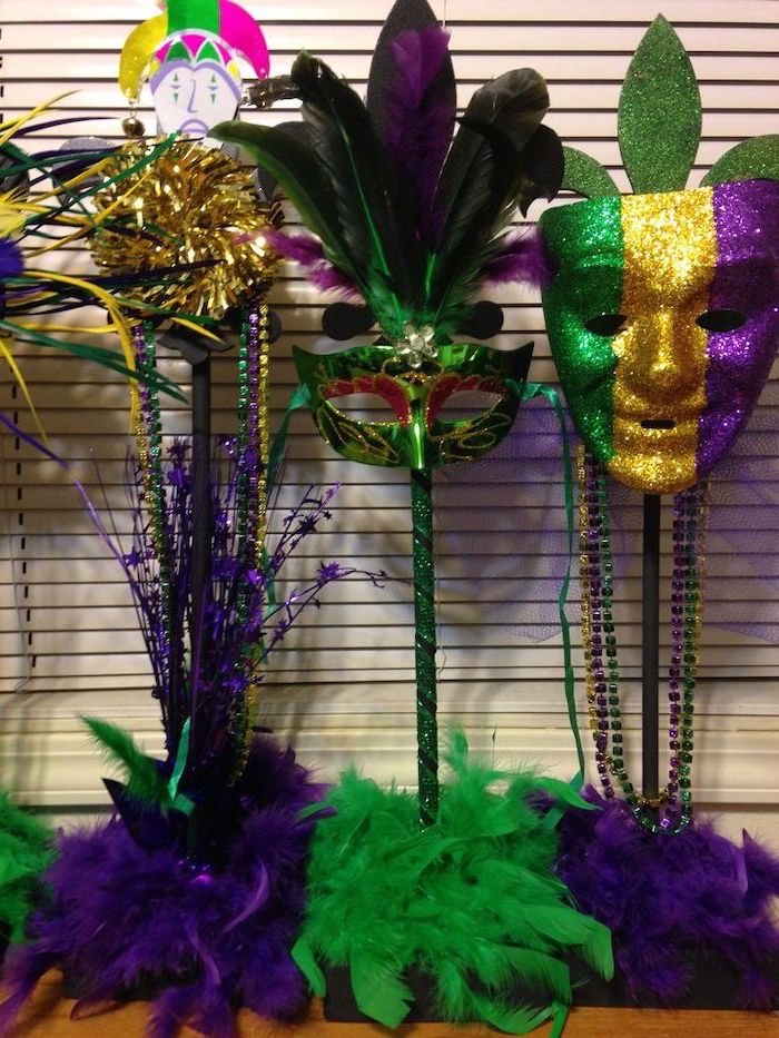 mens mardi gras masks, two different masks, decorated with green gold and purple glitter, purple and green feathers