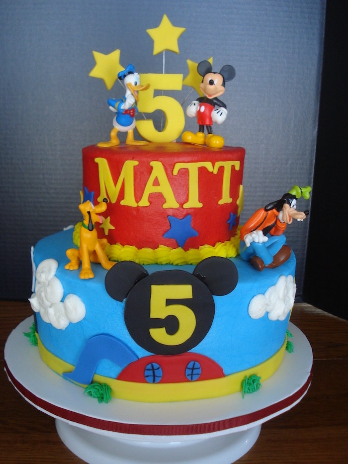 mickey mouse cake decorations, two tier cake, covered with red and blue fondant, disney characters decorations on it