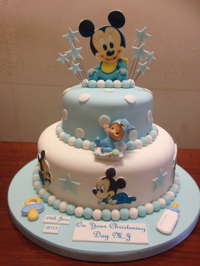 two tier cake for christening, covered with blue and white fondant, mickey mouse cake decorations, mickey cake topper