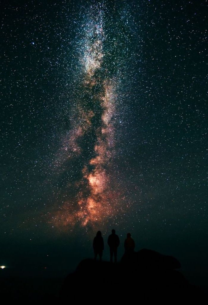 three friends standing on top of a hill, space desktop backgrounds, sky filled with stars above them