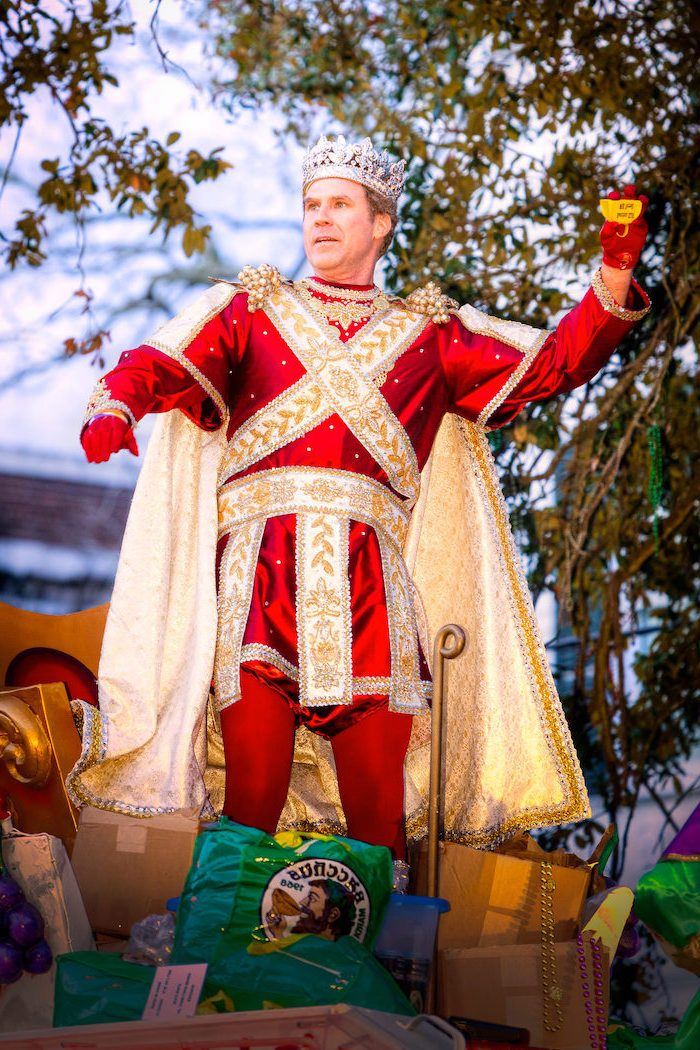 will ferrel as king bacchus, masquerade masks, dressed in red and gold costume, crown on his head