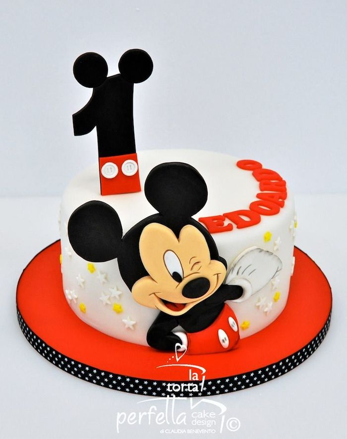 mickey mouse baby shower cake, one tier cake, covered with white fondant, placed on red cake tray