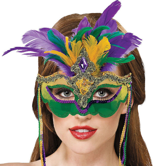 brunette woman with red lipstick, wearing a mask, mens mardi gras masks, decorated in purple green and gold sequins