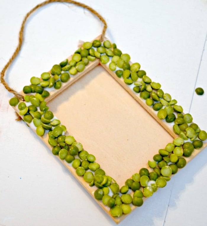 wooden frame covered with split peas, st patricks day decorations, placed on white surface