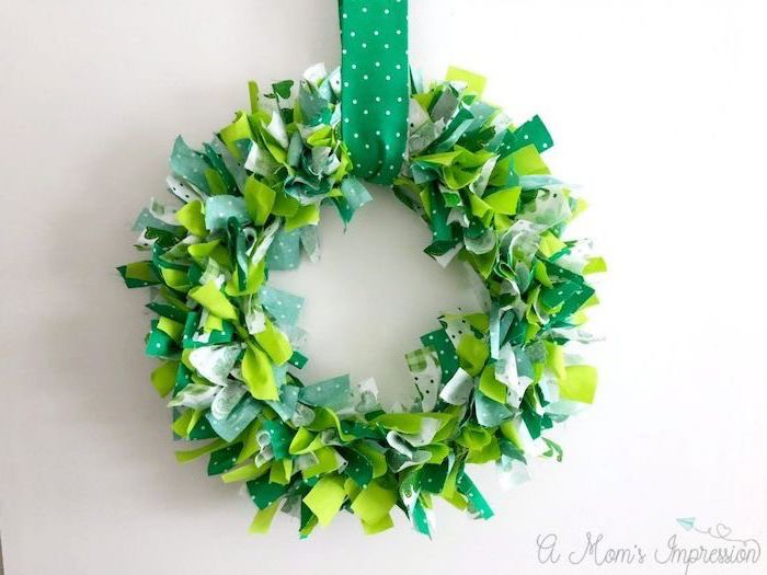 wreath made with green and white ribbons, hanging on white wall, st patricks day games, hanged with green ribbon