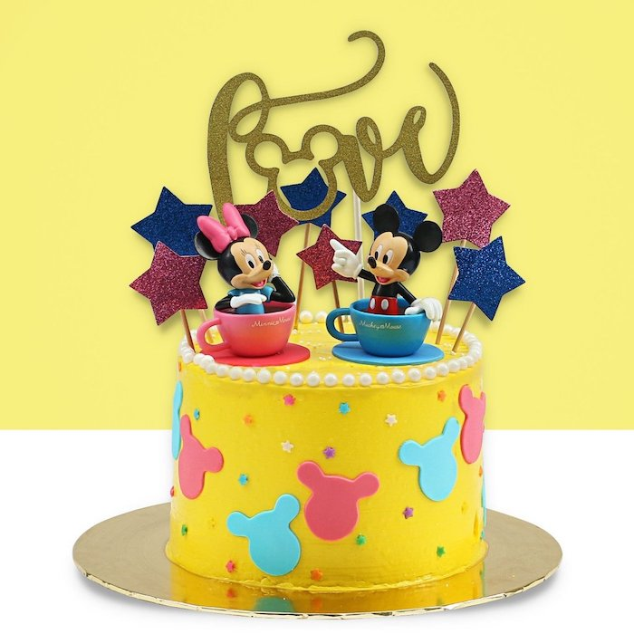 one tier cake, covered with yellow fondant, mickey mouse baby shower cake, mickey and minnie cake toppers