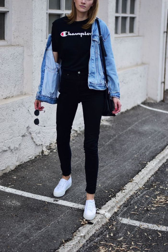 cute outfits for school, woman wearing all black outfit, black champion t shirt and jeans, denim jacket and white sneakers
